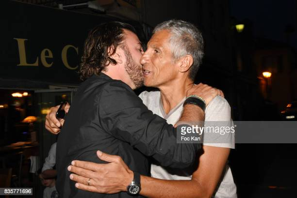 Actors Michael Youn and Nagui attend the 'Carbone' SaintTropez Premiere Outside Arrivals At Cinema La Renaissance Place des LIces on August 19 2017...