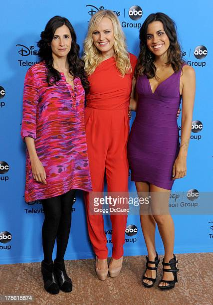 Actors Michaela Watkins Malin Akerman and Natalie Morales arrive at the 2013 Disney/ABC Television Critics Association's summer press tour party at...