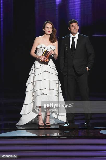 Actors Michelle Dockery and Kyle Chandler speak onstage during the 68th Annual Primetime Emmy Awards at Microsoft Theater on September 18, 2016 in...