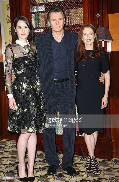Actors Michelle Dockery Liam Neeson and Julianne Moore attend a photocall for 'Non Stop' at The Dorchester on January 30 2014 in London England