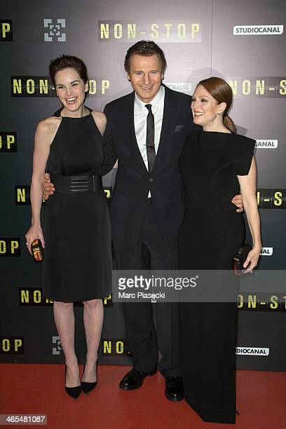 Actors Michelle Dockery Liam Neeson and Julianne Moore attend the 'Non Stop' Paris Premiere at Cinema Gaumont Opera on January 27 2014 in Paris France