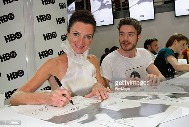Actors Michelle Fairley and Richard Madden attend HBO's Game Of Thrones cast autograph signing at San Diego Convention Center on July 19 2013 in San...