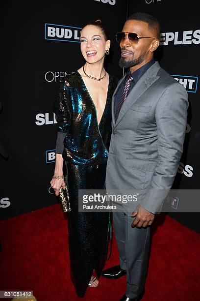 Actors Michelle Monaghan and Jamie Foxx attend the premiere of Sleepless at the Regal LA Live Stadium 14 on January 5 2017 in Los Angeles California