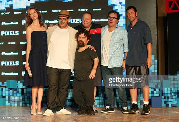 """Actors Michelle Monaghan, Josh Gad, Peter Dinklage, Kevin James, director Chris Columbus, and actor Adam Sandler attend the """"Pixels"""" photo call..."""