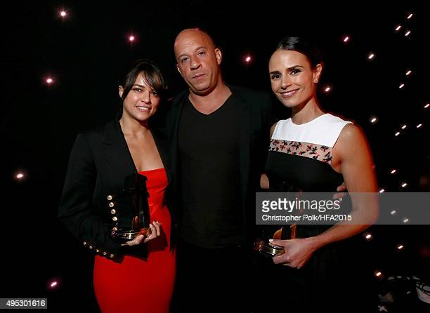 Actors Michelle Rodriguez Vin Diesel and Jordana Brewster pose with the Hollywood Blockbuster Award for 'Furious 7' during the 19th Annual Hollywood...