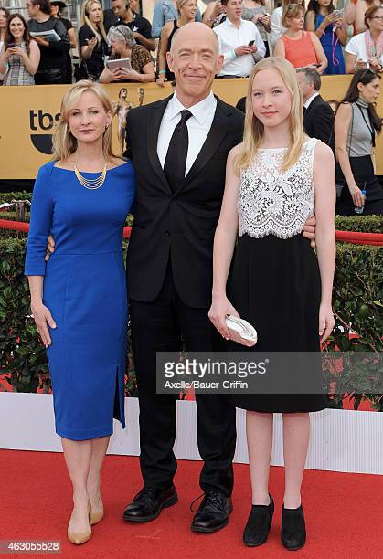 Actors Michelle Schumacher JK Simmons and daughter Olivia Simmons arrive at the 21st Annual Screen Actors Guild Awards at The Shrine Auditorium on...