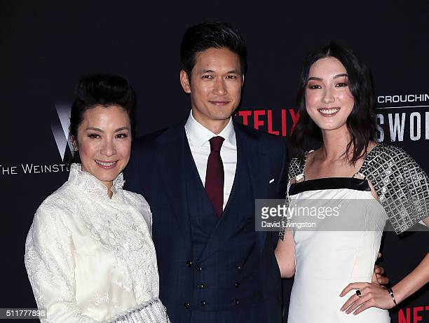 Actors Michelle Yeoh Harry Shum Jr and Natasha Liu Bordizzo attend the premiere of Netflix's Crouching Tiger Hidden Dragon Sword of Destiny at AMC...