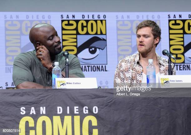 Actors Mike Colter and Finn Jones speak onstage at Netflix's The Defenders panel during ComicCon International 2017 at San Diego Convention Center on...