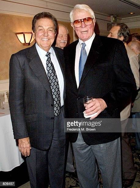 Actors Mike Connors and Peter Graves attend the Pacific Pioneer Broadcasters Lifetime Achievement Luncheon November 16 2001 in Los Angeles CA Connors...
