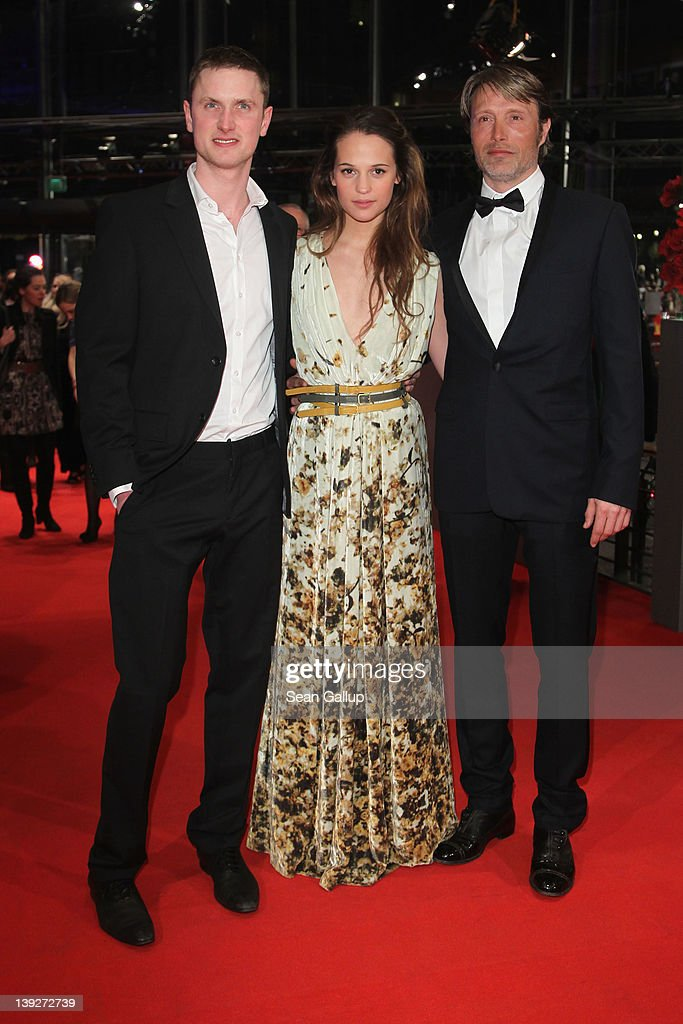 Actors Mikkel Boe Folsgaard, Alicia Vikander and Mads Mikkelsen attend the Closing Ceremony during day ten of the 62nd Berlin International Film Festival at the Berlinale Palast on February 18, 2012 in Berlin, Germany.