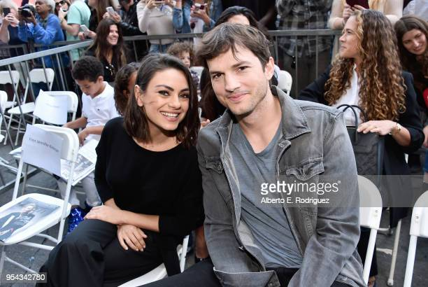 Actors Mila Kunis and Ashton Kutcher at the Zoe Saldana Walk Of Fame Star Ceremony on May 3 2018 in Hollywood California