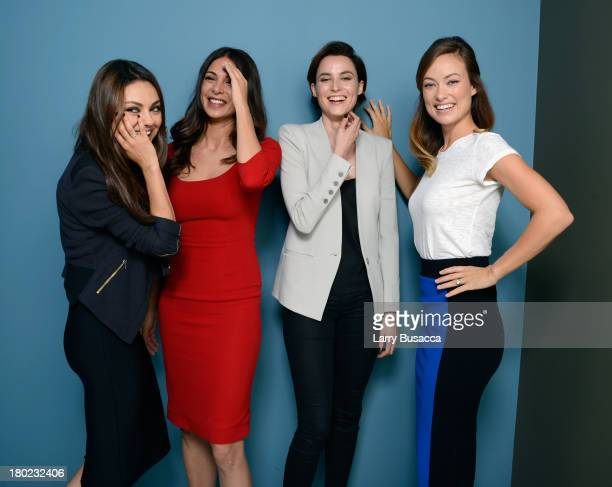 Actors Mila Kunis Moran Atias Loan Chabanol and Olivia Wilde of 'Third Person' pose at the Guess Portrait Studio during 2013 Toronto International...