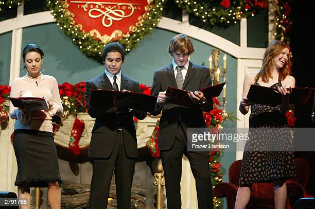 Actors Mila Kunis Wilmer Valderrama Ashton Kutcher and Laura Prepon perform on stage at the Church of Scientology's 11th Annual Christmas Stories...