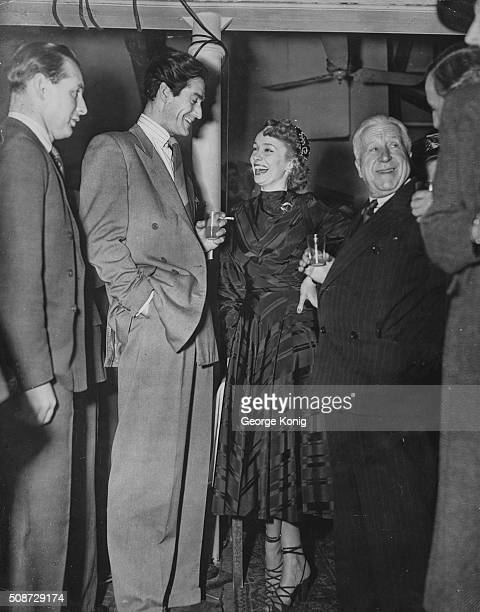 Actors Mila Parely Guy Rolf and Edward Rigby drinking at a Jubilee Film party celebrating the 25th film produced by Gainsborough Studios December 9th...