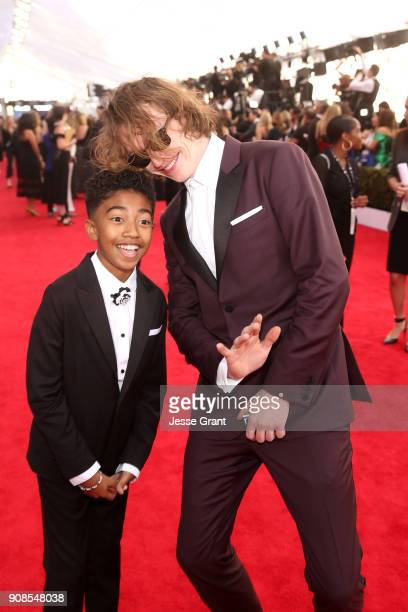 Actors Miles Brown and Caleb Landry Jones attend the 24th Annual Screen ActorsGuild Awards at The Shrine Auditorium on January 21 2018 in Los...
