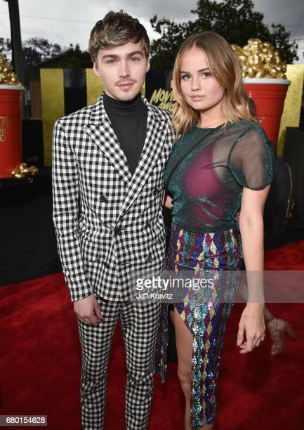 Actors Miles Heizer and Debby Ryan attend the 2017 MTV Movie And TV Awards at The Shrine Auditorium on May 7 2017 in Los Angeles California
