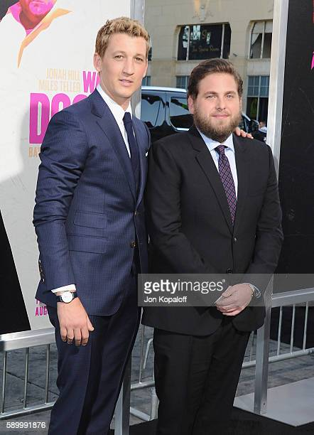 """Actors Miles Teller and Jonah Hill arrive at the Los Angeles Premiere """"War Dogs"""" at TCL Chinese Theatre on August 15, 2016 in Hollywood, California."""