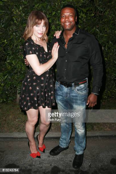 Actors Milla Jovovich and Chris Tucker attend Cinespia Presents The Fifth Element at Hollywood Forever on July 15 2017 in Hollywood California