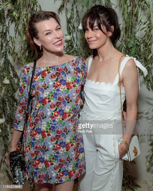 Actors Milla Jovovich and Michelle Monaghan attend the Shani Darden Studio opening on June 06 2019 in Beverly Hills California
