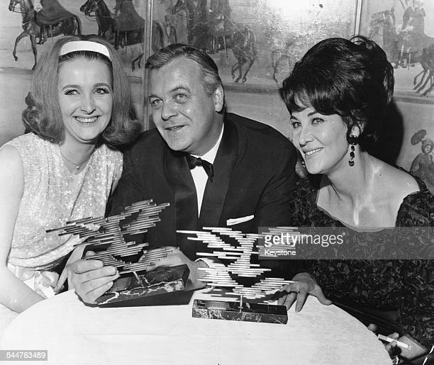 Actors Millicent Martin Patrick Wymark and Katherine Blake after receiving their awards at the Annual Ball of the Guild of TV Producers and Directors...
