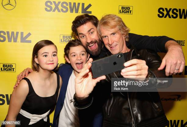 Actors Millicent Simmonds Noah Jupe director John Kransinski and producer Michael Bay attend the Opening Night Screening and World Premiere of 'A...