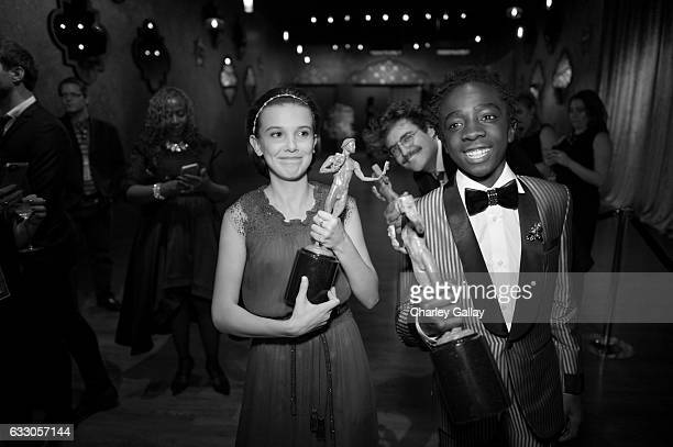 Actors Millie Bobby Brown and Caleb McLaughlin attend The 23rd Annual Screen Actors Guild Awards at The Shrine Auditorium on January 29 2017 in Los...