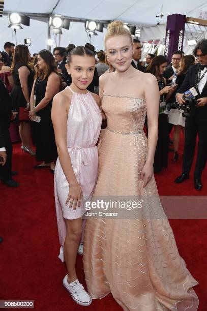 Actors Millie Bobby Brown and Dakota Fanning attend the 24th Annual Screen Actors Guild Awards at The Shrine Auditorium on January 21 2018 in Los...