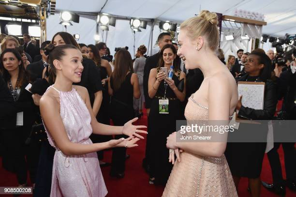 Actors Millie Bobby Brown and Dakota Fanning attend the 24th Annual Screen Actors Guild Awards at The Shrine Auditorium on January 21, 2018 in Los...