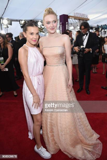 Actors Millie Bobby Brown and Dakota Fanning attend the 24th Annual Screen ActorsGuild Awards at The Shrine Auditorium on January 21 2018 in Los...
