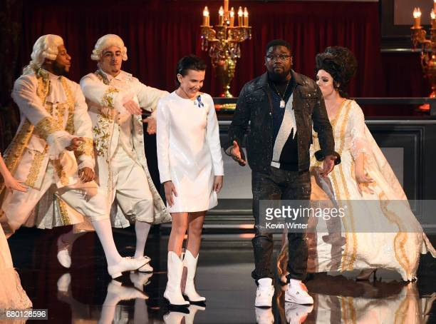 Actors Millie Bobby Brown and Lil Rel Howery speak onstage during the 2017 MTV Movie And TV Awards at The Shrine Auditorium on May 7 2017 in Los...