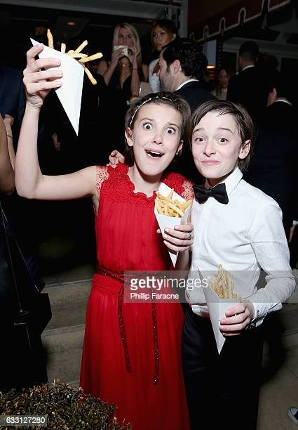 Actors Millie Bobby Brown and Noah Schnapp attend The Weinstein Company Netflix's 2017 SAG After Party in partnership with Absolut Elyx at Sunset...