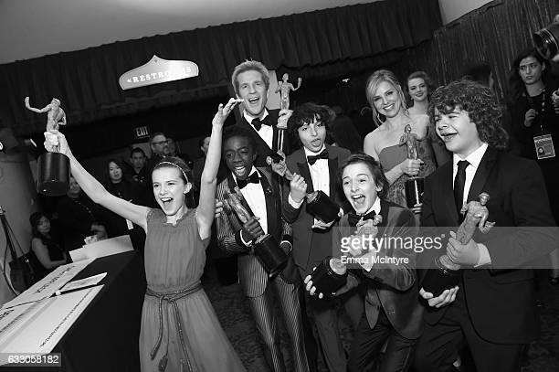 Actors Millie Bobby Brown Caleb McLaughlin Matthew Modine Finn Wolfhard Noah Schnapp Cara Buono and Gaten Matarazzo winners of the Outstanding...