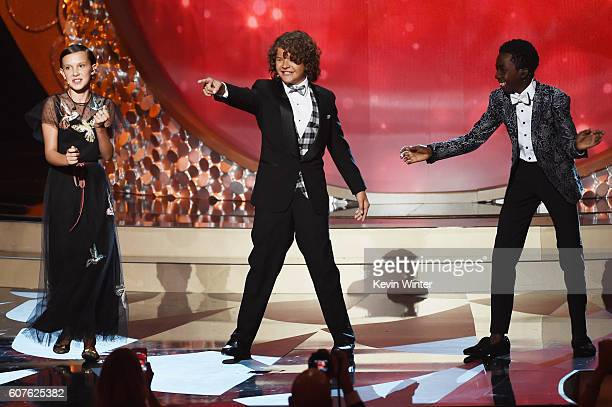 Actors Millie Bobby Brown Gaten Matarazzo and Caleb McLaughlin perform onstage during the 68th Annual Primetime Emmy Awards at Microsoft Theater on...