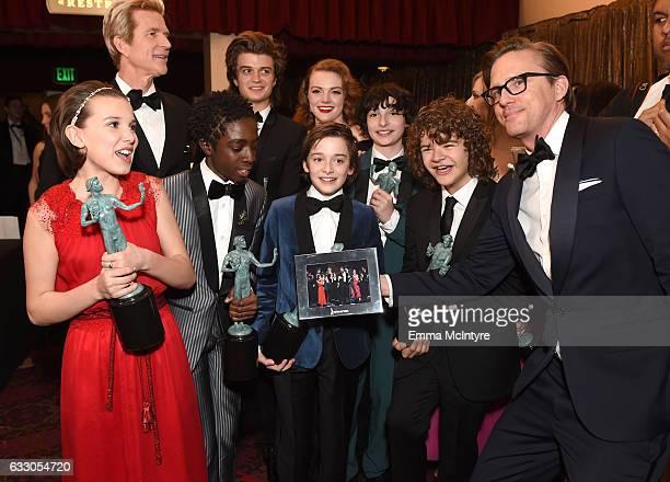 Actors Millie Bobby Brown Matthew Modine Caleb McLaughlin Joe Keery Shannon Purser Noah Schnapp Finn Wolfhard and Gaten Matarazzo winners of the...