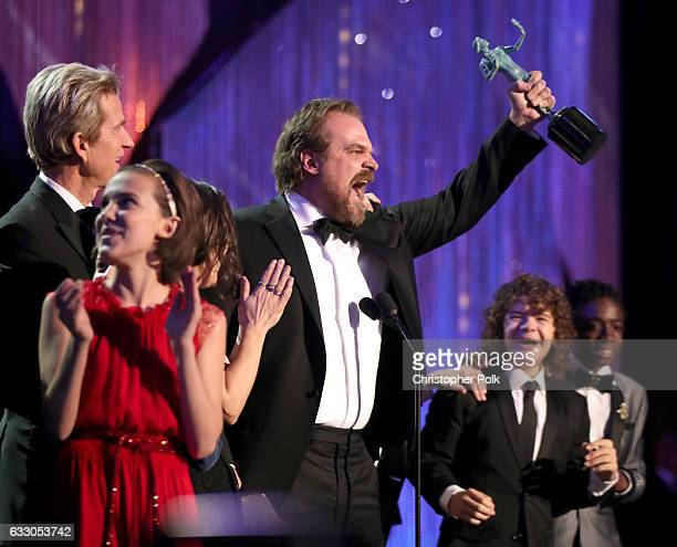 Actors Millie Bobby Brown Matthew Modine David Harbour Gaten Matarazzo and Caleb McLaughlin accepting the award for Ensemble in a Drama Series during...