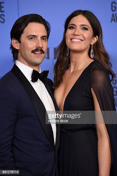 Actors Milo Ventimiglia and Mandy Moore pose in the press room at the 74th Annual Golden Globe Awards at The Beverly Hilton Hotel on January 8 2017...