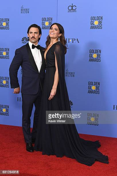 Actors Milo Ventimiglia and Mandy Moore pose in the press room during the 74th Annual Golden Globe Awards at The Beverly Hilton Hotel on January 8...