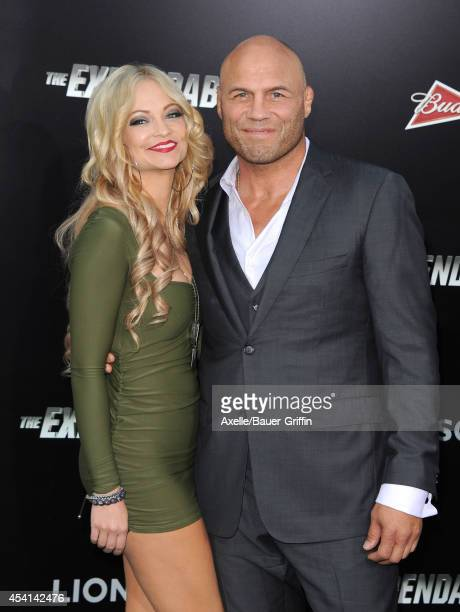 Actors Mindy Robinson and Randy Couture arrive at the Los Angeles premiere of 'The Expendables 3' at TCL Chinese Theatre on August 11 2014 in...
