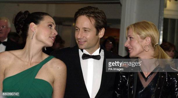 Actors Minnie Driver David Duchovny and Joely Richardson arrive at the premiere of their film Return to Me attended by the Prince of Wales at the...