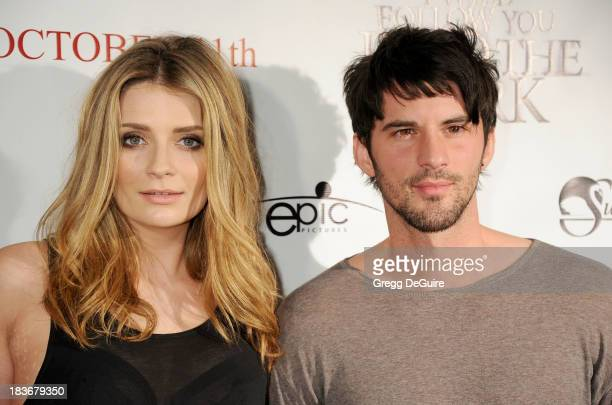 Actors Mischa Barton and Jaz Martin arrive at the Los Angeles premiere of 'I Will Follow You Into The Dark' at the Landmark Theater on October 8 2013...