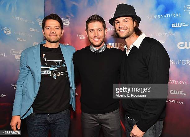 Actors Misha Collins Jensen Ackles and Jared Padalecki attend the CW's Fan Party to Celebrate the 200th episode of 'Supernatural' on November 3 2014...