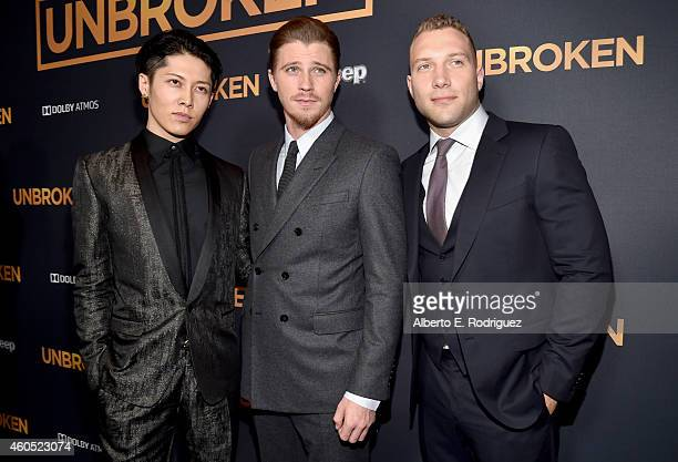 Actors Miyavi Garrett Hedlund and Jai Courtney attend the premiere of Universal Studios' 'Unbroken' at TCL Chinese Theatre on December 15 2014 in...