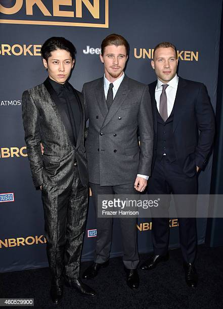 Actors Miyavi Garrett Hedlund and Jai Courtney attend the Premiere Of Universal Studios' Unbroken at TCL Chinese Theatre on December 15 2014 in...