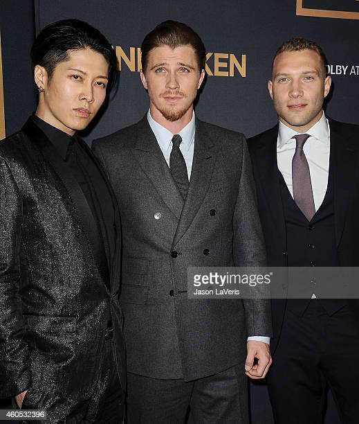 Actors Miyavi Garrett Hedlund and Jai Courtney attend the premiere of 'Unbroken' at TCL Chinese Theatre IMAX on December 15 2014 in Hollywood...