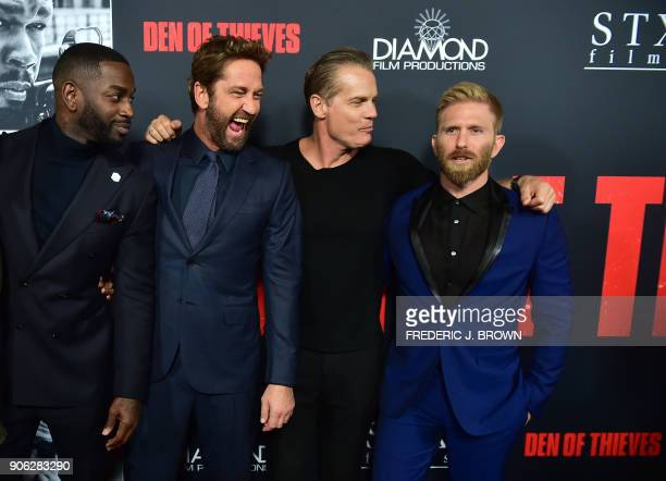 Actors Mo McRae Gerard Butler Brian van Holt and Kaiwi Lyman pose on arrival for the premiere of the film Den of Thieves in Los Angeles California on...
