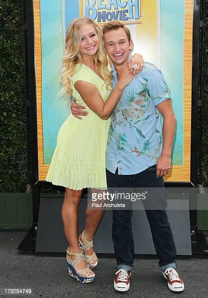 Actors Mollee Gray and Kent Boyd attend the cast reunion of 'Teen Beach Movie' for movie night at Walt Disney Studios on July 10 2013 in Burbank...