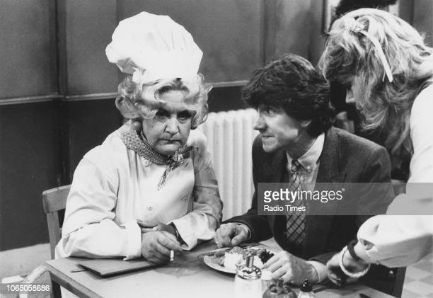 Actors Mollie Sugden Mike Berry and Wendy Richard in a scene from episode 'Goodbye Mrs Slocombe' of the television sitcom 'Are You Being Served' June...