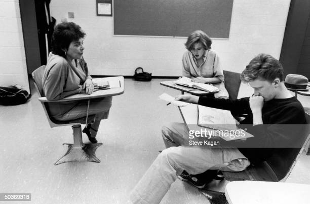 Actors Molly Ringwald and Anthony Michael Hall studying w tutor Irene Branfstein while on location shooting The Breakfast Club