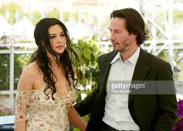 Actors Monica Bellucci and Keanu Reeves pose during The Matrix Reloaded photocall at the 56th International Cannes Film Festival 2003 on May 15 2003...