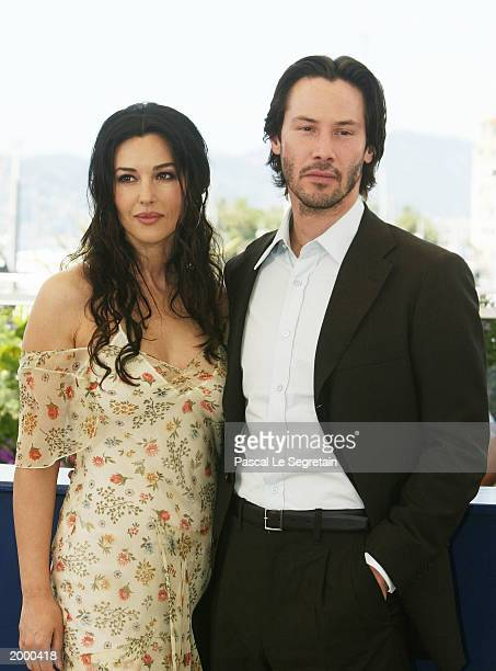 Actors Monica Bellucci and Keanu Reeves pose for the cameras during a photocall for the film The Matrix Reloaded at the Palais des Festivals during...